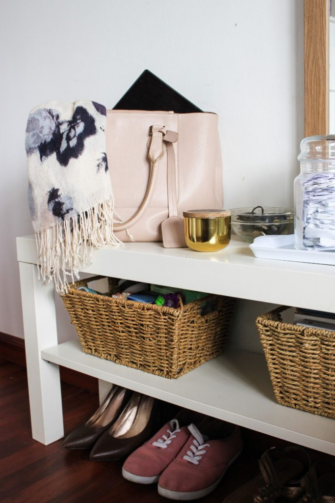 Use multipurpose furniture and baskets in a small bedroom