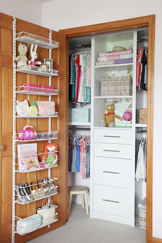 Your closet doors are goldmines for hidden storage to maximize space in a small bedroom