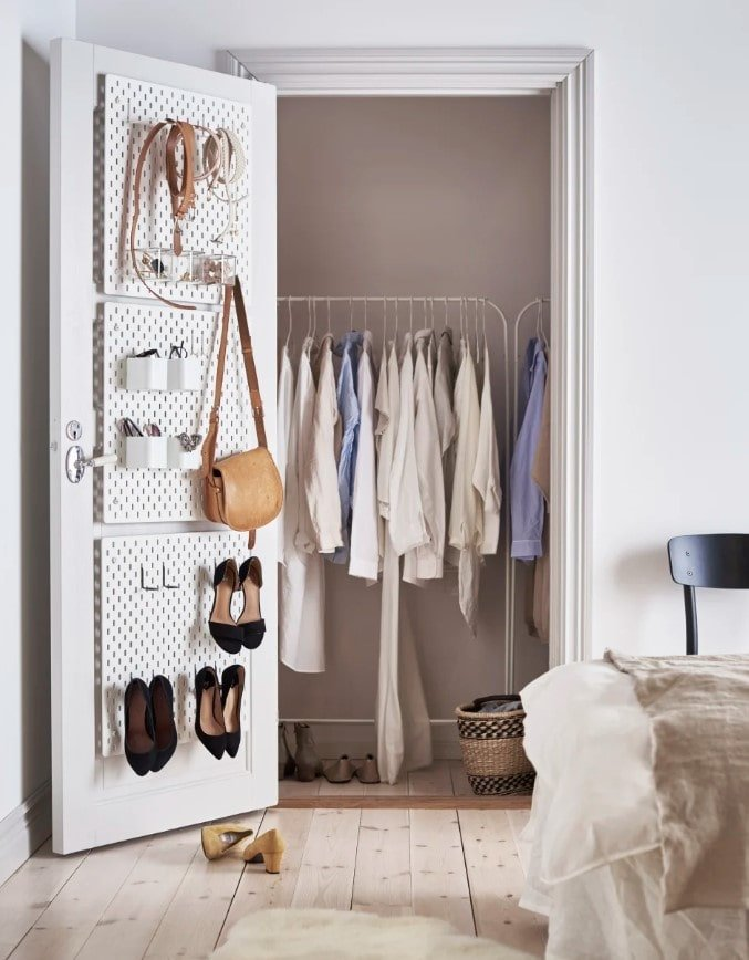 Your closet doors are goldmines for hidden storage to maximize space in a small bedroom and these ikea pegboards are a great storage option for your closet