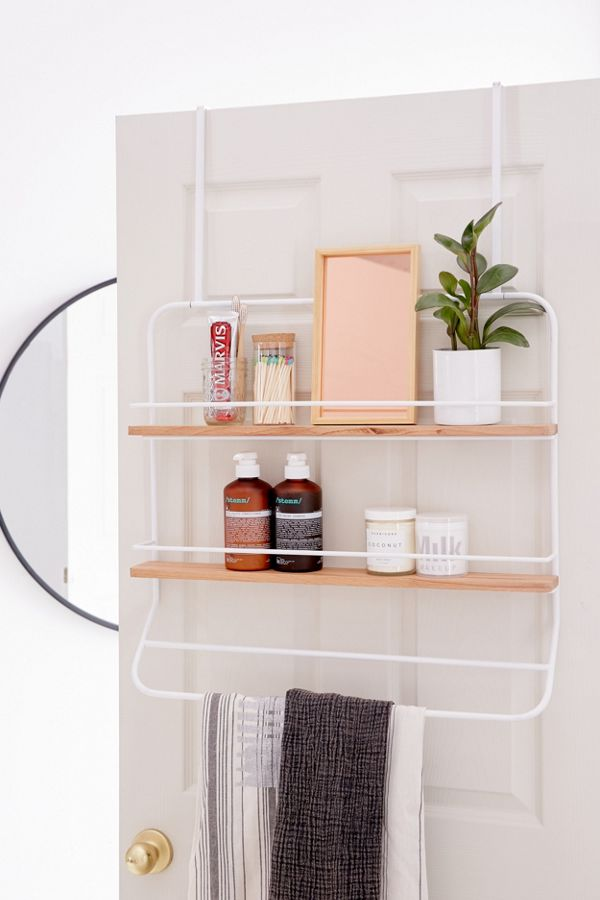 Over the door storage is a key way to maximize space in a small bedroom