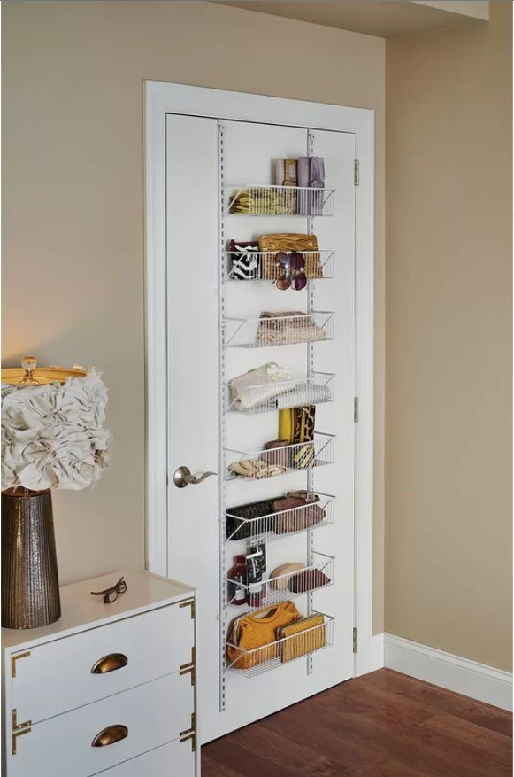 Over the door storage is a key way to maximize space in a small bedroom while keeping your belongings out of sight.